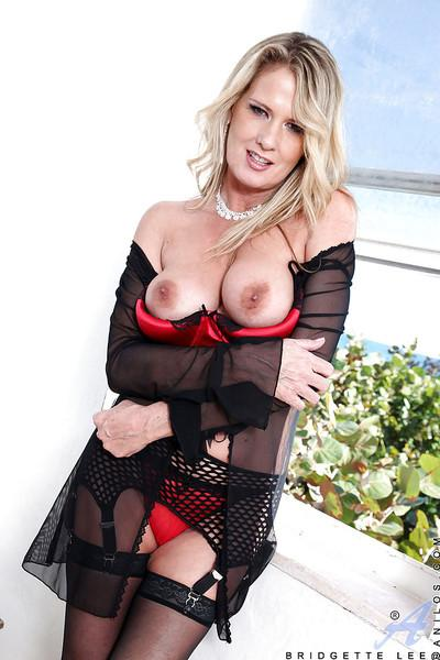 Busty MILF in stockings and sexy lingerie Bridgette Lee flashing her snatch