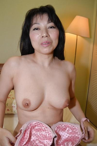 Awesome brunette Shigeko Yokoi demonstrates her sweet boobies