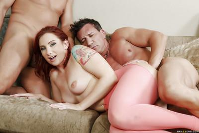 Tattooed redhead Sophia Locke getting spit-roasted by two large cocks