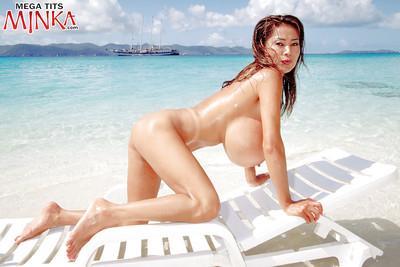 Asian beach babe Minka unleashing massive MILF tits from bikini outdoors