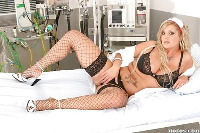 Curvy MILF in stockings stripping off her nurse uniform and lingerie