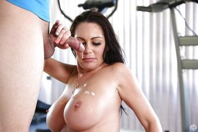 Brunette milf Dayton Raines is getting a load of sperm on her face