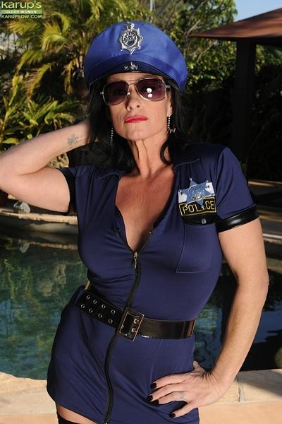 Older MILF Braxton Kai posing by swimming pool in policeman