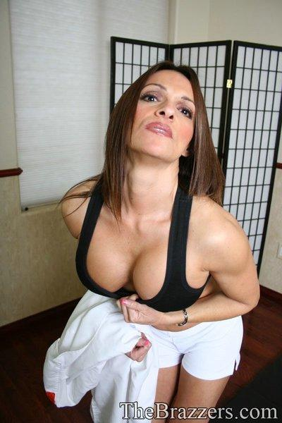 Sports MILF babe takes off uniform to feel her spread cunt