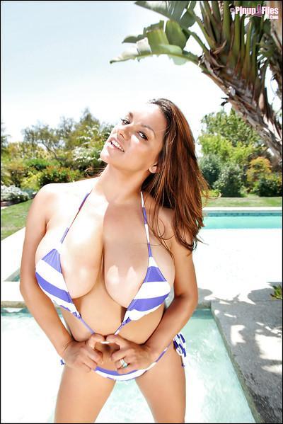 Unbelievably busty brunette Monica Mendez showcasing her huge tits
