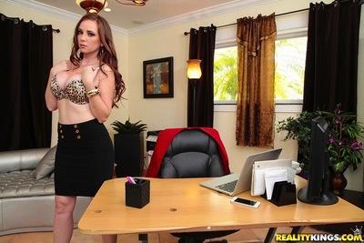MILF Jessica Rayne posing seductively in black skirt and high heels