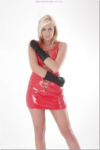 Beautiful blonde MILF striking sexy poses in pink latex dress