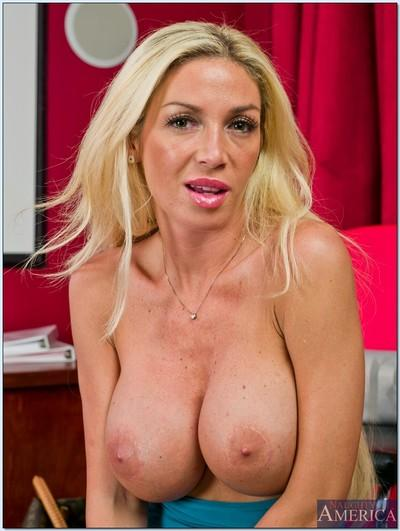 Sultry blond MILF Evita Pozzi showing her huge tits and shaved pussy