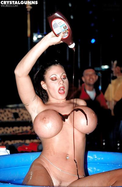 Busty MILF babe Crystal Gunns sheds cowgirl outfit at strip club