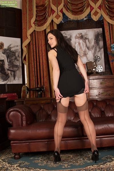 Sultry Euro MILF Michelle Khan modelling in nylons and garters