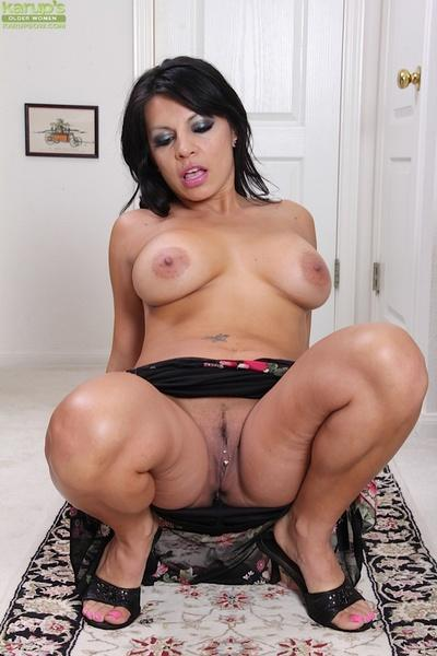 Awesome brunette with big tits Eva undressing and spreading her puss