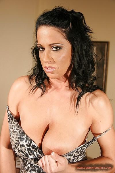 Raven haired MILF with big jugs Andrea Black stripping in the office