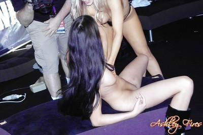 Lesbians Ashley Fires and Bree Olson strapon fucking at porn convention