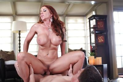 Redheaded MILF Janet Mason rides cock and gets fucked very hard