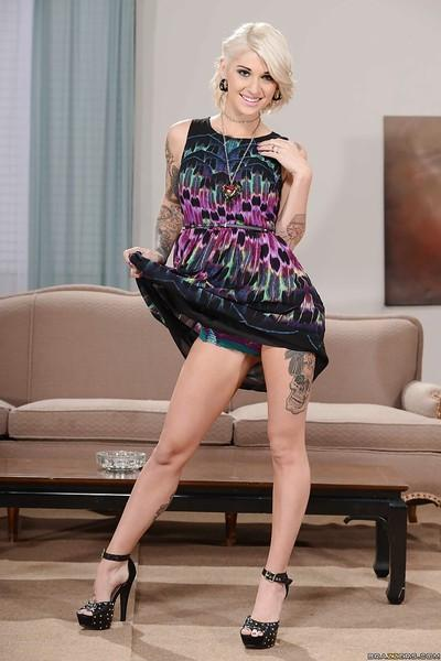 Tattooed milf Kleio Valentien looks amazing during undressing process