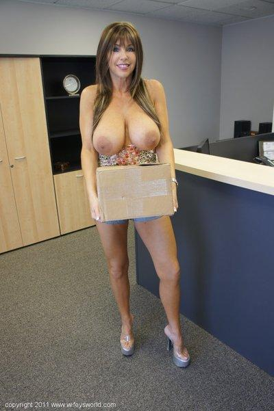 Hot MILF in shorts Wifey exposes her giant natural boobs in the office