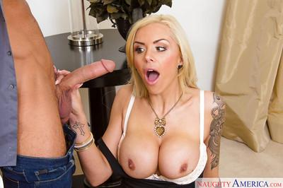 Tattooed blonde Nina Elle is sucking and licking this hard dick