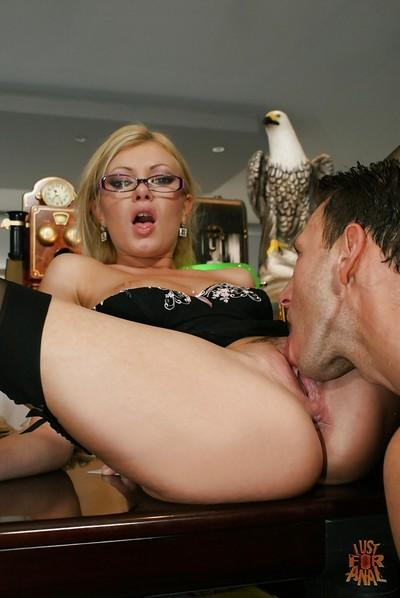 Blonde secretary in glasses taking cumshot in mouth after being ass fucked