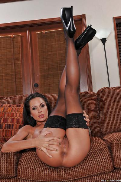 MILF pornstar in stockings shows her cunt and wears a strapon
