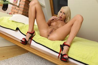 Well-graced blonde babe Lena Love playing with her sex toys