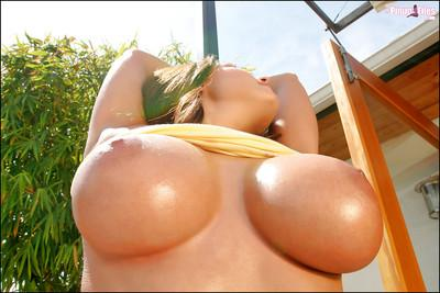 Milf babe Erica Campbell lets loose her big breasts outdoors