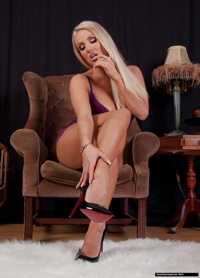 European slut Dannii Harwood is showing off her long legs in high heels