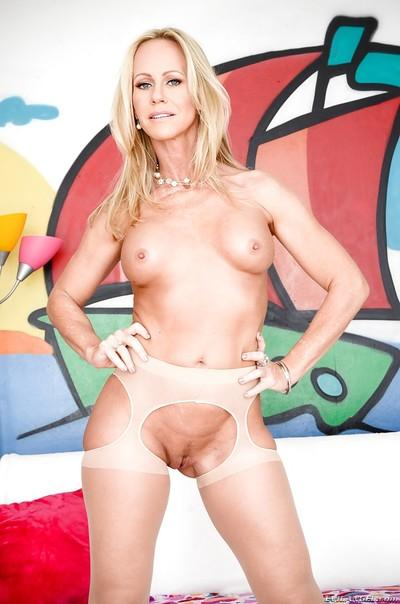 Naughty MILF in sexy pantyhose taking off her lingerie and exposing her holes