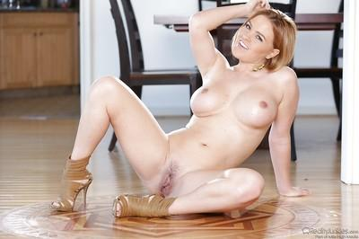 Smiley MILF Krissy Lynn getting naked and exposing her gorgeous curves