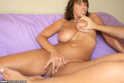 Lusty MILF with big bosoms masturbates her cunt and gives a great titjob