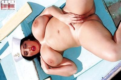 Plump European pornstar Kerry Marie frees massive tits from uniform outside