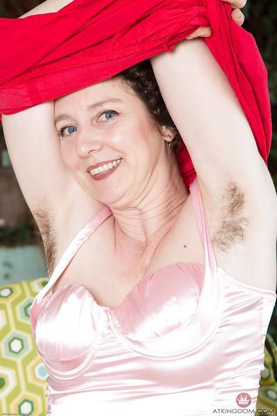 Experienced hirsute model Artimesia revealing hairy armpits outdoors
