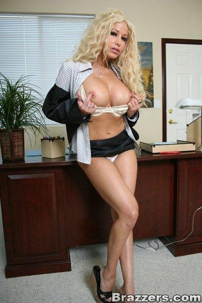Latin hottie Gina Lynn strips in the office and shows MILF tits