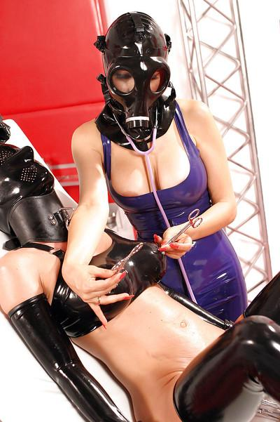 Three gorgeous babes in latex outfits are into kinky femdom action