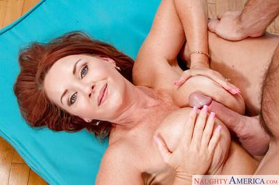 Busty cougar Janet Mason taking dick from muscular young stud