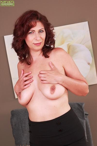 Busty older MILF Laila Fereschte releasing large all natural breasts