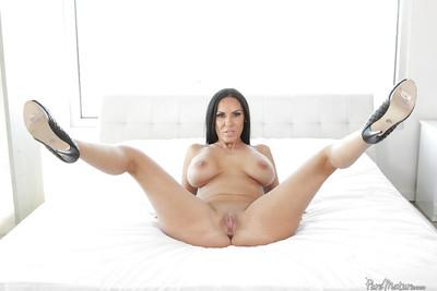 Brunette solo girl Veronica Rayne unleashing large MILF hooters