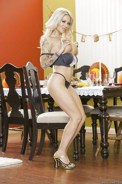 Tattooed blonde with shapely tits undressing and spreading her legs