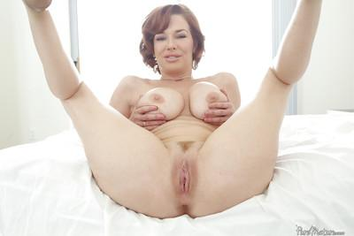 Redhead MILF Veronica Avluv plays with big knockers while fingering pussy