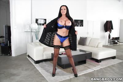 Busty brunette pornstar Nikki Benz having a smoke while posing in lingerie