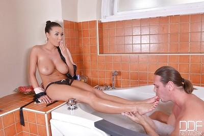 Milf Patty Michova takes a bath and gives a great slippery footjob