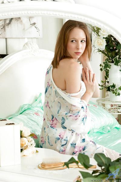 Pretty Euro babe Katie White posing for sexy solo poses in white stockings
