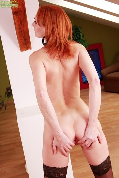 Older redheaded MILF Bachova posing for non nude lingerie photos