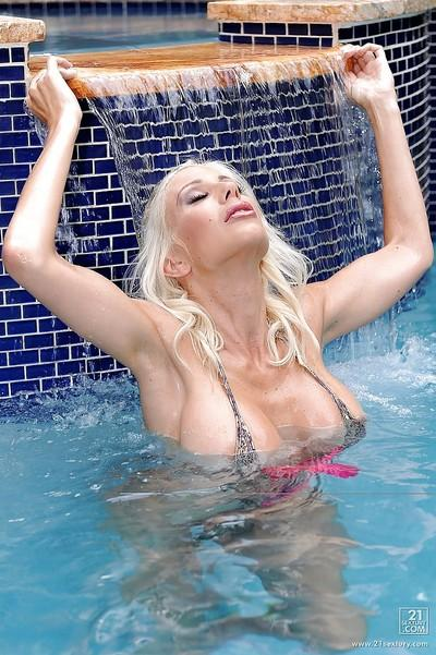 Puma Swede spreading her pussy and making it wet in the pool