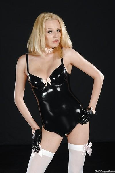Alluring blonde in latex outfit and stockings exposing her petite ass