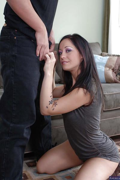 Beautiful brunette Kylee King is standing on her knees with dick