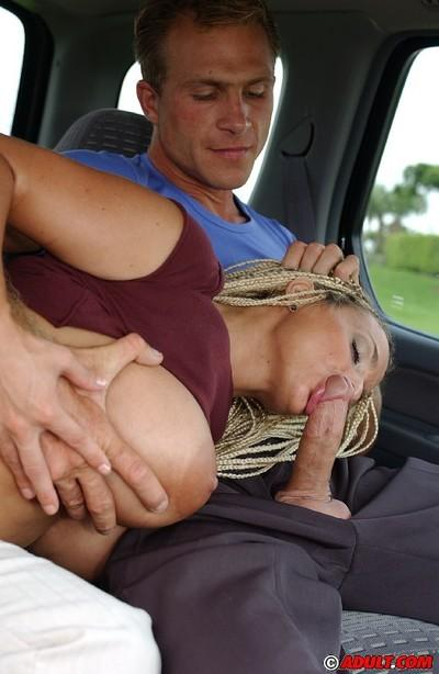 Slutty MILF with boobacious tatas goes down on a stiff cock in the car