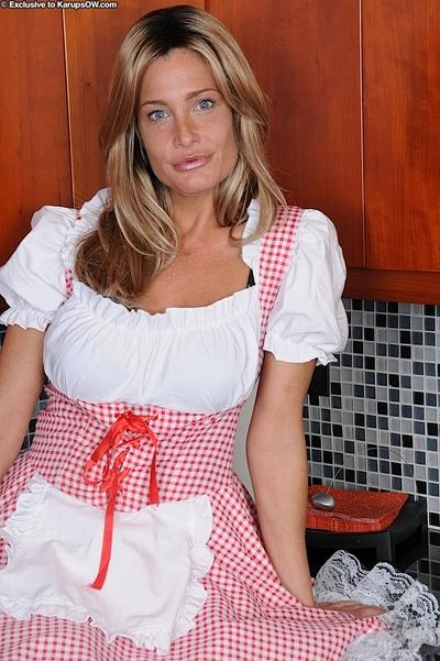 Stunning blonde MILF in fancy maid uniform undressing and exposing her goods