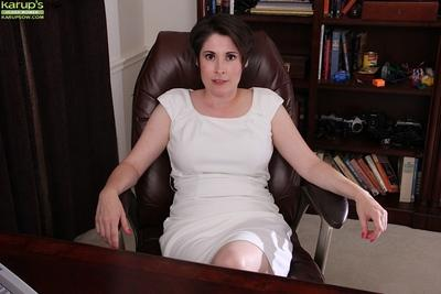 Chunky older mom in glasses Sadie Jones posing fully clothed in white dress