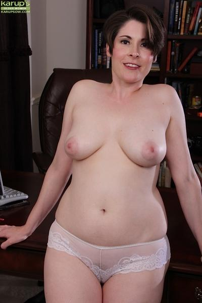 Chunky older mom in glasses Sadie Jones posing fully clothed in white dress