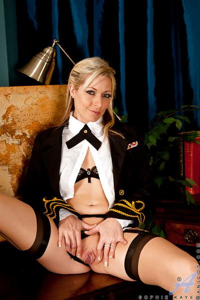 Playful MILF in sexy uniform getting naked and spreading her legs